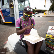 19 DECEMBER, 2013 - Philani Dladla sits on Empire road in Braamfontein, Johannesburg, next to the University of the Witwatersrand (WITS), selling and reviewing books to passerbys in their cars. Picture: DANIEL BORN © THE TIMES